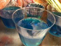Ocean Jello for kids! I made these for Esabella's 5th bday party (little mermaid theme). Super cute and easy. You will need: small clear plastic cups,  Crushed graham cracker (sand),blue Jello (ocean), Shark Bites fruit snacks, Green sour straw candy (seaweed). The kids love making them  almost as much as they love eating them :)