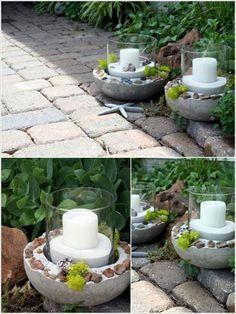 déco de jardin en béton - des porte-bougies ovales décorés de cailloux et mousse