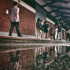 Singapores Urban Landscapes Reflected in Puddles by Yafiq Yusman 2014