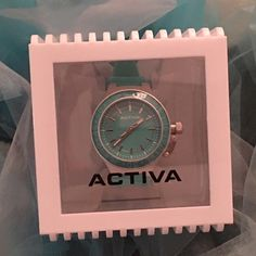"""NEW Invicta """"Activa"""" Sports Watch NEW In Box Beautiful Activa by Invicta Women's Sports Watch In Tiffany BlueAdjustable 28mm x 9"""" Polyurethane Bezel and BandDurable Aluminum Case 40mm x 12mmWater Resistance 5atmSwiss Parts Quartz MovementBattery Operated Invicta Accessories Watches"""