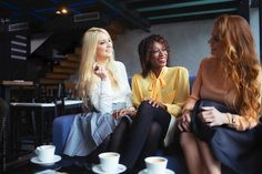 Smiling Women Sitting at a Café by Lumina for Stocksy United