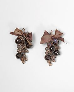 Merlot bauble earring    Reminiscent of succulent grape clusters, faceted garnet beads sway beneath a dainty silk ribbon dyed by hand and tied in a bow. 1 3/4 in. on bronze-plated French wires. Glass, mixed metals.