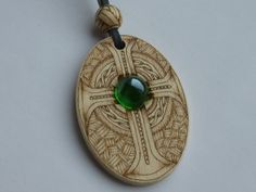 """Wooden pendant """"Celtic Woven Cross"""" decorated with pyrography and glass"""