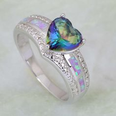 Add some romance to your next outing. A mystic topaz heart stone serves as the focal point, while pink opals and white cubic zirconia stones adorn the sterling silver shank. RING DETAILS - Width: 8 mm