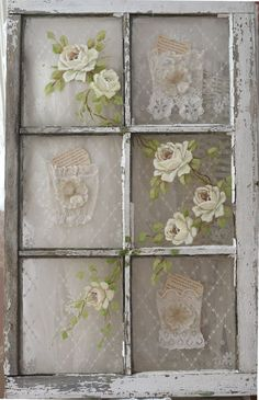 This old window has a delicate feel. I added vintage lace as the backdrop with hand made lace pockets that I tucked a piece of old paper inside for interest...  Love this!!