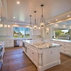 i love this beautiful kitchenthe marble counters white cabinets and the beadboard celing with that beautiful shade of wood floor