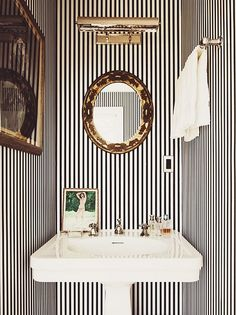 Powder room inspiration- love the stripes mixed with brassy-goldish accents, the light and pedestal sink. Kate and Andy Spade's striped powder room. Room Design, Interior, Home, Striped Wallpaper, Powder Room Design, Small Bathroom, Bathroom Decor, Beautiful Bathrooms, Bathroom Inspiration