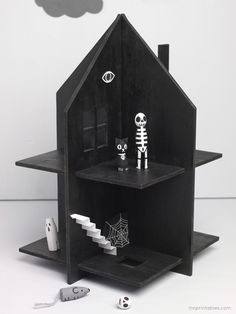 DIY Haunted Dolls House Make this haunted dolls house with cardboard or plywood, with tips for making Halloween peg dolls Haunted Dollhouse, Haunted Dolls, Diy Dollhouse, Dollhouse Miniatures, Haunted Houses, Haunted Forest, Haunted Mansion, Halloween Crafts For Kids, Holidays Halloween