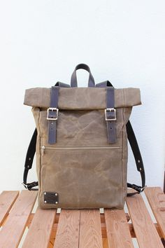 It was handcrafted of: • 12 oz. English waxed canvas • Harness leather for straps • YKK metal zipper • Stainless steel hardware  Size when rolled: 43x30x12 cm. (17*12*4.7 inches) Big front zipper pocket. Two pockets inside. Color: Olive green  You can choose between brown, black and natural beige leather color.  Brown leather straps: https://www.etsy.com/listing/225777434/waxed-canvas-backpack-rolltop-with-brown  Natural beige leather straps…