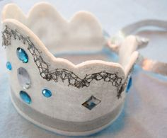 Cinderella felt crown with satin ribbon. We can totally make these for all the girls and price charming ones for the boys instead of party hats :)