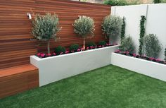 modern garden design low maintenance scheme fake grass easi easy lawn hardwood bench raised concrete walls olives topiary screen privacy trellis cedar hardwood battersea clapham balham vauxhall