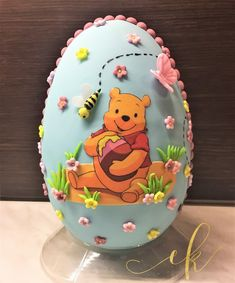 Decorated Chocolate Easter egg for a little girl who loves Winnie the Pooh! Chocolate Decorations, Cookie Jars, Easter Eggs, Winnie The Pooh, Little Girls, Sweets, Toddler Girls, Winnie The Pooh Ears, Gummi Candy