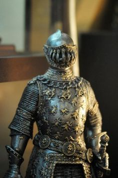 Full armour suit, appears 16th century. Note the tight-fitting close helm with jointed visor, and the complex decoration work on the cuirass.