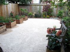 decomposed granite and raised planters. A great way to eliminate grass