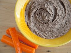 Black Bean Hummus 2 15 ounce cans of black beans drained 3 cloves of garlic 1 tbsp of olive oil 2 tbsp of tahini 4 tbsp of lemon juice 1 tsp of cumin 1/2 tsp of sea salt  Place all of the ingredients in a food processor or blender and process until smooth. This version is toddler friendly. If you like it spicy, add in 1/4 -  1/2 tsp of chili powder. You can also add more garlic or more cumin to taste.