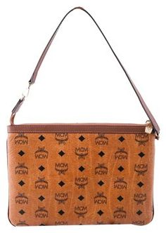 f412d6c74 GB1031422k MCM POUCH WITH STRAP Visetos pouch with leather trim and studded  detailing Gold-toned. Tradesy