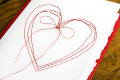 heart stitched paper