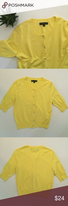 "Express Bright Yellow Cardigan Bright sunny yellow cardigan from Express! Has silver bling buttons! Minor pilling at underarms, but otherwise great condition! 3/4 length sleeves. 18 1/4"" long, 16"" pit to pit, sleeves 6 1/4"", bottom hem 12"" across. 80% rayon, 17% nylon, 3% spandex. NO TRADES. Express Sweaters Cardigans"