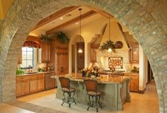 I love the archway and the island in this kitchen. Plus the colors are amazing!