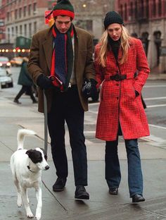 Carolyn Bessette Kennedy, John F. Kennedy, Jr. and Friday in Manhattan. LOVE her red coat.