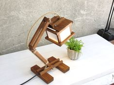 Kran Paus - minimal style desk lamp A stylish wooden lamp MADE TO ORDER. I name the lamps in my collection by the row I create them. This one is called Paper Lantern Lights, Lantern Lamp, Desktop Lamp, Geometric Lamp, Wooden Lamp, Unique Lamps, Bedroom Lamps, Minimalist Decor, Diy Room Decor