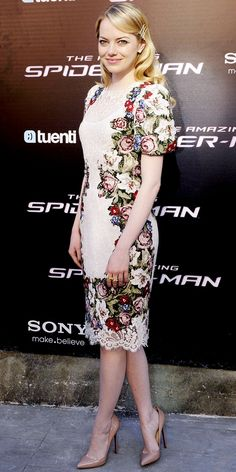 Emma Stone  WHAT SHE WORE  At the Madrid premiere of The Amazing Spider-Man, Stone walked the red carpet in a floral Dolce & Gabbana sheath, diamond studs and nude Christian Louboutin pumps.