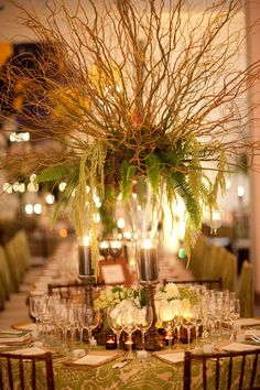 Willow branches, fern, and moss create a dreamy rustic centerpiece!