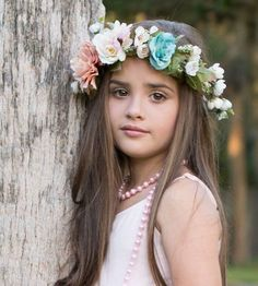 This flower crown has a beautiful combination of garden blooms in muted colors. Perfect for your flower girls, bridesmaids, festivals, photo shoots. Available in child and adult sizes. Adjustable for