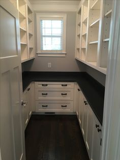 large pantry ideas Large walk-in pantry with white shaker cabinets and honed dark granite Pantry Laundry Room, Walk In Pantry, Pantry Closet, Kitchen Pantry Design, New Kitchen, Narrow Kitchen, Cheap Kitchen Cabinets, Base Cabinets, Kitchen Cabinetry