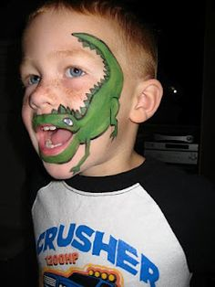 Dino face paint.  I think my grandson would look so cute with this on!
