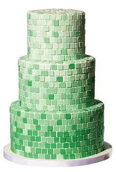 Brides.com: The Most Creative Wedding Cakes of the Year. BMQ Desserts, New York, NY. Ombré is a huge wedding cake trend. This mosaic look with hand-cut tiles is a modern twist for a springtime wedding.  Tiled green ombré wedding cake, $14 per slice (serves 200), BMQ Desserts  See more modern wedding cakes.