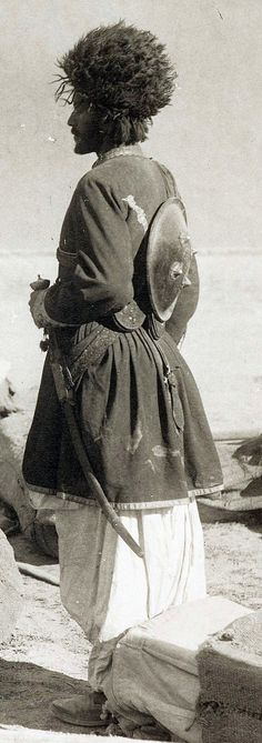 Afghan warrior, (1895), shown with pulwar sword and shield.