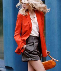 love the red orange blazer.