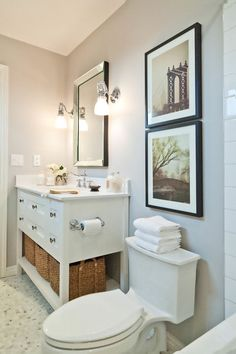 Guest Picks: Lighting to Perk Up a Powder Room  Sconces and pendants in classic, contemporary and even glam styles to brighten a small half bath    traditional bathroom by Vanessa Francis