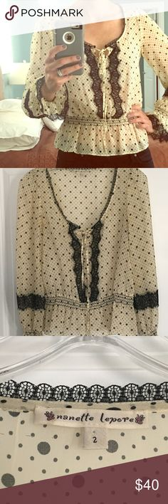 Nanette Lepore cream black polka dot lace top Nanette Lepore black and cream polka dot lace top. Tie front. Size 2. Originally purchased at Bloomingdales for $200. Nanette Lepore Tops