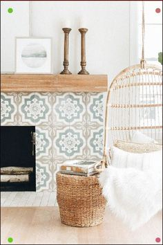 A tan and blue Moroccan style tiled fireplace boasts a rustic wood mantel and is positioned behind a Serena & Lily Hanging Rattan Chair paired with a woven ottoman. Wood Mantels, Fireplace Mantels, Tiled Fireplace, Fireplaces, Mantle, Oak Mantel, Craftsman Fireplace, Fireplace Design, Wood Furniture Living Room