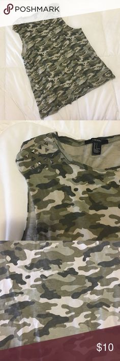 Camo Tank Top Perfect for those who are feeling a bit rebellious! This camo tank top from forever 21 will make you feel sassy and in control. Camo print with studded shoulder detail and low cut arm holes. Looks great with a bralette or bandeau. Size S. Forever 21 Tops Muscle Tees