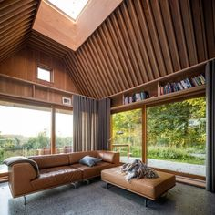 Douglas fir planks frame the building's interior, providing warmth and good acoustics, while also creating in-built furniture and shelving. Living Room Modern, Living Spaces, Living Rooms, Copper Beech, Wood Supply, The Door Is Open, Nature Color Palette, Cabin Design, Villa Design