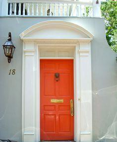 gray house + white trim + orange door