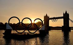 London 2012 Olympics: in pictures July 27 - Good morning: sunrise over Tower Bridge and the Olympic Rings in central London this morning Picture: PA