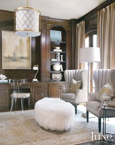 This study is glamorous and sophisticated with its muted color palettes and transitional décor.