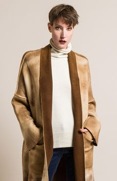 $1,375.00   Avant Toi Cashmere and Virgin Wool Oversized Cardigan in Caramel   Avant Toi clothing, by Mirko Ghignone, is avant garde and elegant. It is created by using experimental hand-dyeing and processing on fine fabrics and textiles. The line crosses into elegant and artistic with a grungy aesthetic. This cream cashmere cardigan is simple yet textural in color. Avant Toi is sold online and in-store at Santa Fe Dry Goods & Workshop in Santa Fe, New Mexico.