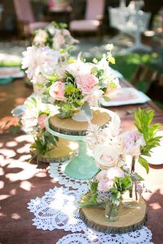 Long shot of florals by Fujiko's Flowers. Wood slices, vintage containers, vintage doilies, cake stands courtesy of Minted and Vintage. #mint and #pink #babyshower
