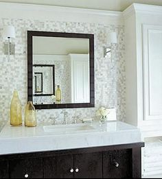 Thick marble vanity with storage below.
