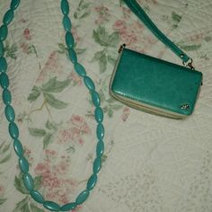 Squeal for Teal!! Teal color wristlet (cell phone case/wallet combo) and matching necklace (32 inches). Black cell holder fits Samsung S3 and is secured in place with Velcro.  But this piece can be removed and secure your own phone by adding Velcro. Accessories