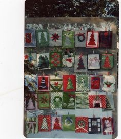 """this are handmade """"quilted"""" Christmas cards made of scraps of fabrics and ribbons etc. They were fastened over batting on card stock. Each one was individual Christmas Ideas, Christmas Cards, Fabric Scraps, Ribbons, Advent Calendar, Card Stock, Fabrics, Quilts, Blanket"""