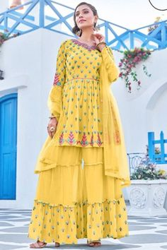 Be the cynosure of all eyes by wearing this yellow georgette sharara suit which makes you effortlessly fashionable. This sweetheart neckline and full sleeve apparel perfectly formed using thread and faux mirror. Completed with georgette sharara pants in yellow color with yellow net dupatta. Sharara pants has thread and faux mirror work. #shararasuits #malaysia #Indianwear #weddingwear #andaazfashion Indian Attire, Indian Wear, Pantalon Cigarette, Sharara Suit, Costume, Asian Woman, Frocks, Party Wear, Bell Sleeves