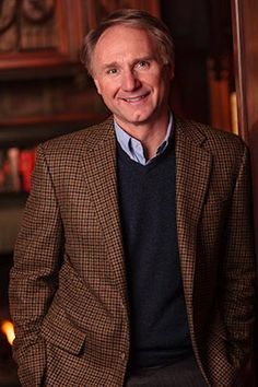 Dan Brown, author, donning a tweed blazer. His hard-core New England style is behind his protagonist,  Harvard-nerd professor, Dr Robert Langdon.