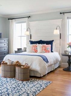 Fresh Bedroom Inspiration | Navy and Coral | White Bedding | Light Blue Walls | Hardwood Floor | Tall White Headboard