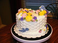 Cake design idea for my decorating class. sans birds. I'm doing basketweave but don't want to look like I'm just piling my nicest flowers on the cake. Although that's totally what I'll be doing.